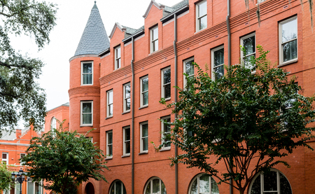 turret: Old Red Brick Building with Turret Windows in Savannah Stock Photo