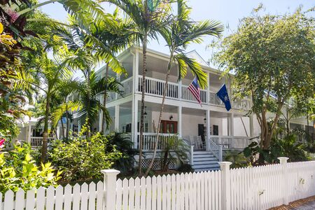 american flags: Traditional wood siding home in Florida with American flag