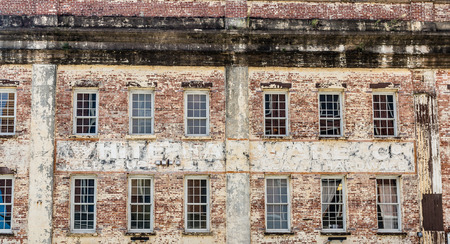 empty warehouse: Windows in Old Brick Warehouse in Savannah