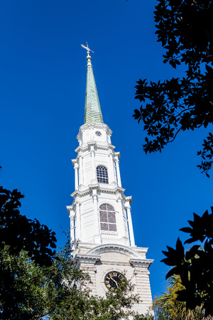 church steeple: A white church steeple against a clear blue sky Stock Photo