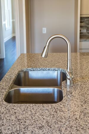 granite kitchen: New Brushed Nickel Fixture on Granite Countertop in new kitchen