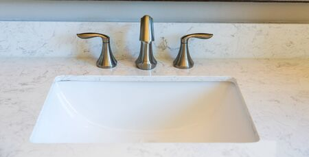 expensive granite: Brushed Nickel faucets on Marble Vanity Stock Photo