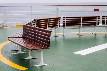 helicopter pad: Empty Benches on Helicopter Pad of a Cruise Ship Stock Photo