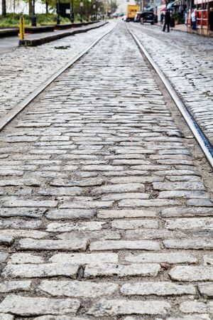 cobblestone: Steel Tracks in Cobblestone Street in Savannah