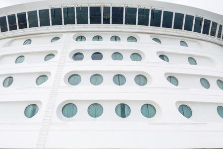 ship bow: Portholes on the bow of a large luxury cruise ship