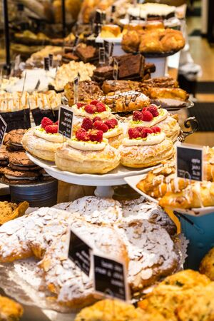bakery products: Many Pastries in a Bakery Display case