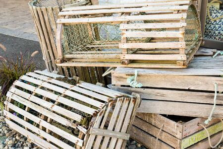 Old Wood Lobster Traps on a Dock Stock Photo