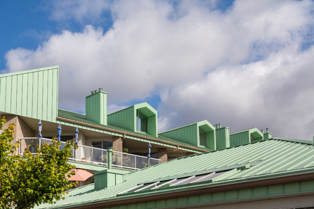 Green Metal Roof on Apartment building