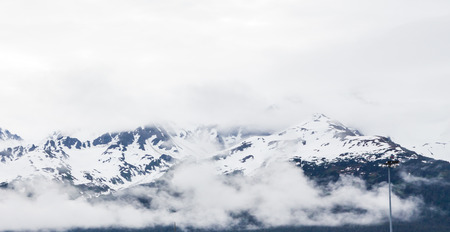 cloud capped: Snow on Misty Mountains in Alaska