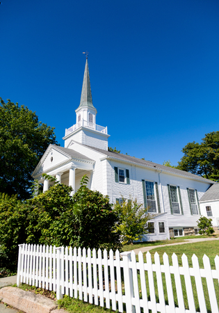 picket: White Church Beyond Picket Fence under blue sky