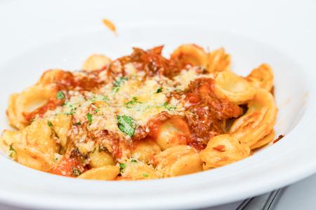 marinara sauce: Bowl of Cheese Tortellini with Tomato Sauce Stock Photo