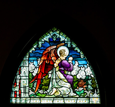 stain glass: Arched stain glass window in church on black background Stock Photo