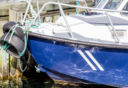 hull: Blue Hull with Tire Bumpers in harbor