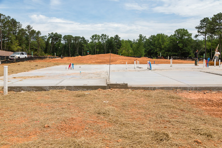 residential construction: Slab poured on new residential construction site Stock Photo