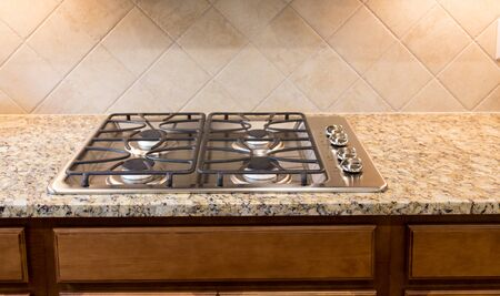 cooktop: Stainless Gas Cooktop on Granite Countertop