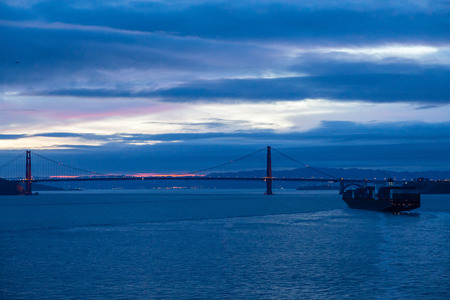 freighter: A freighter sailing into San Francisco harbor at night Stock Photo
