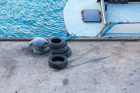 bollard: Old Tires by Bollard on Pier on Bonaire