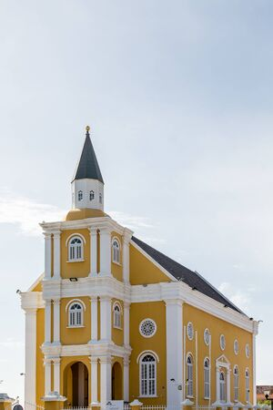 curacao: An old yellow and white plaster church on Curacao Stock Photo