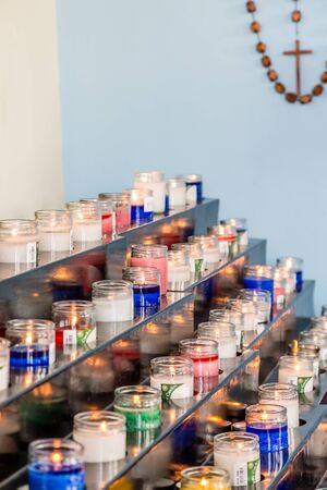 candlelight memorial: Many colorful candles for the dead in a Catholic Church