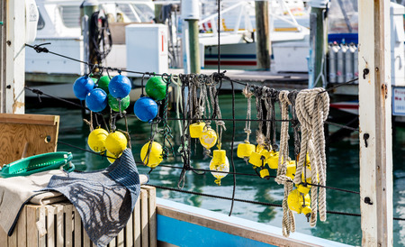 floats: Colorful Floats on Railing in harbor Stock Photo