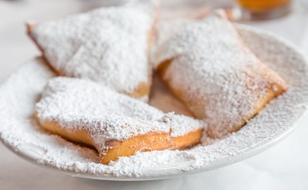 powdered: Beignets on Plate with powdered sugar