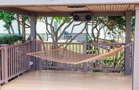 tropics: Brown Hammock on Wood Deck in Tropics