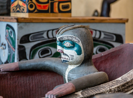 northwest indian art: Sculpture of Totem in Carved Inuit Canoe
