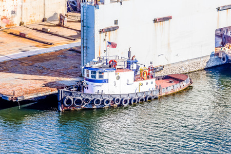 tampa bay: A tugboat at an industrial pier in Tampa Bay