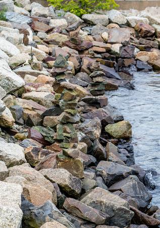 港の護岸の花崗岩の岩 写真素材