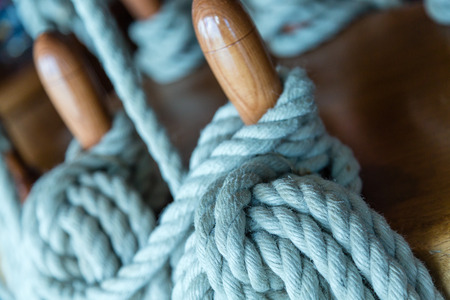 belaying: Blue Rope on Wood Belaying PIns on Yacht