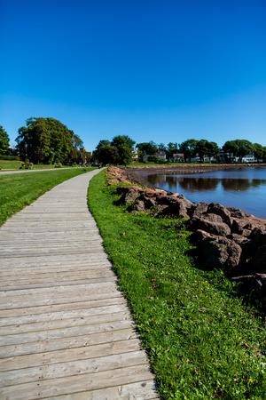 Wood Walkway by Rock Seawall in Canada
