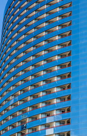 Curving Blue Balconies on Modern Glass Hotel Stock Photo