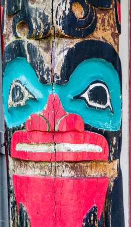 northwest indian art: Old Red and Blue Totem Stock Photo
