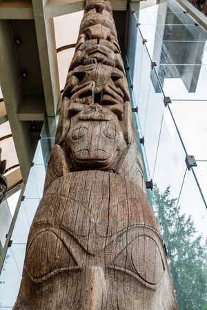 northwest indian art: Ancient Totem Pole Rising into Glass Lobby of building
