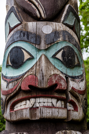 northwest indian art: Ancient Inuit Totem in Alaska Stock Photo
