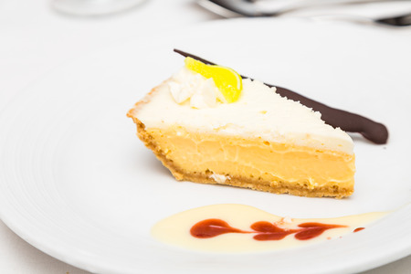 florida citrus: Key Lime Pie with Sauce and Knife Stock Photo