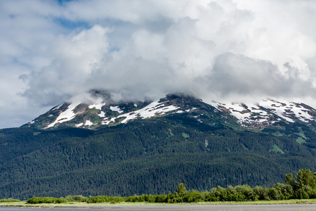cloud capped: Icy mountains in Alaska into the clouds Stock Photo