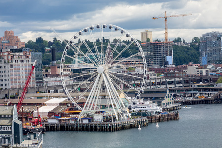 puget: Waterfront architecture of Seattle featuing the new ferris wheel