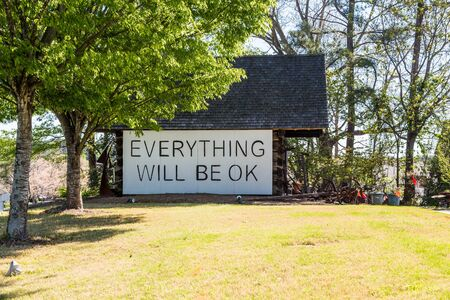 alright: A sign saying everything will be ok on an old barn
