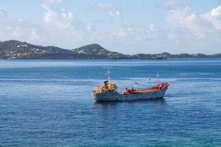 unloading: Old Rusty Crane Ship in Harbor