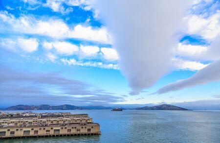 alcatraz: Alcatraz Prison Beyond San Francisco Piers Under Nice Clouds