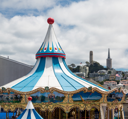 Top of carousel with two towers in the background