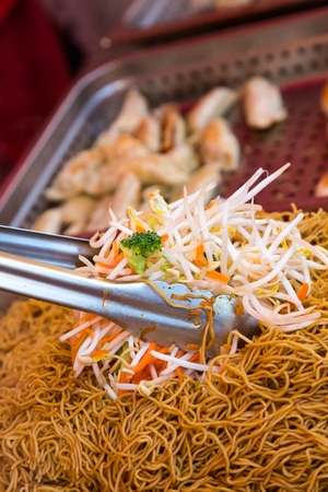 Mixing Vegetables and Lo Mein in Vancouver Night Market Stock Photo
