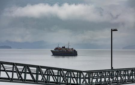 Alaskan Ferry cutting through fog Stock Photo