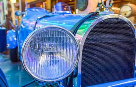 Chrome Headlight on Classic Blue Roadster