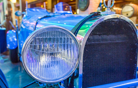 Chrome Headlight on Classic Blue Roadster
