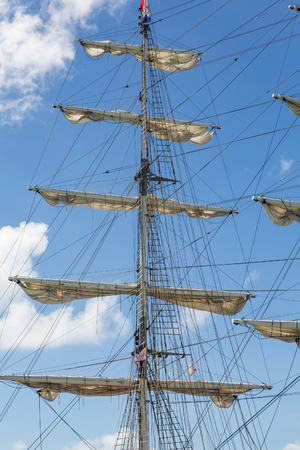 furled: Sails Furled on Fore Mast of Schooner Stock Photo