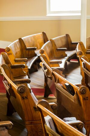 pews: Wood pews inside a small church in Canada
