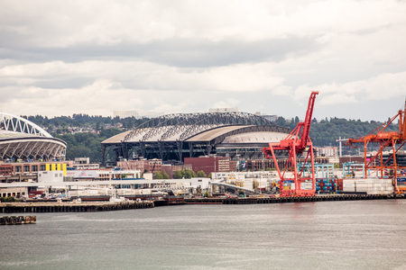 Seattle waterfront with boats, freight, and two stadiums