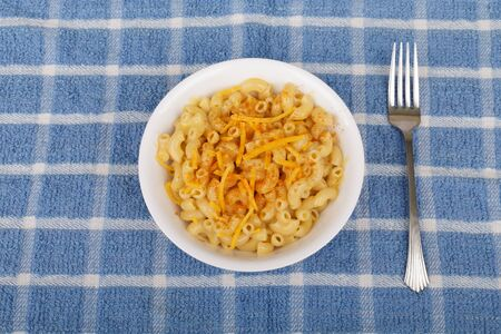 Bowl of macaroni and cheese with red cayenne pepper